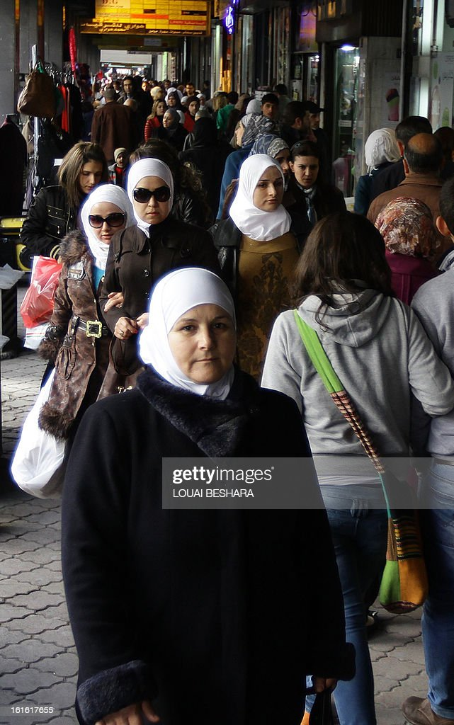 Syrian women shop at a souq in Damascus on February 13, 2013. Syria's state news agency SANA cited electricity minister Imad Khamis as saying widespread blackouts have caused economic losses of around $2.2 billion since March 2011.