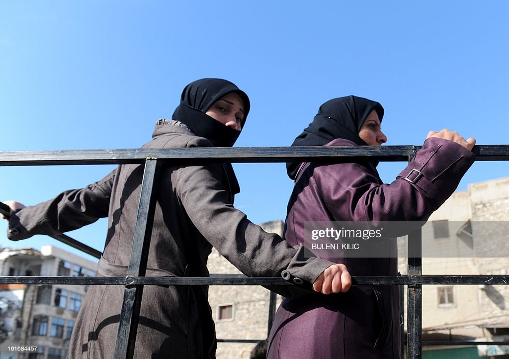 Syrian women travel in the back of a truck in the northern city of Aleppo on February 14, 2013. Syrian Foreign Minister Walid al-Muallem and opposition National Coalition chief Ahmed Moaz al-Khatib will make separate visits to Moscow for talks in the coming weeks, a top Russian diplomat said.