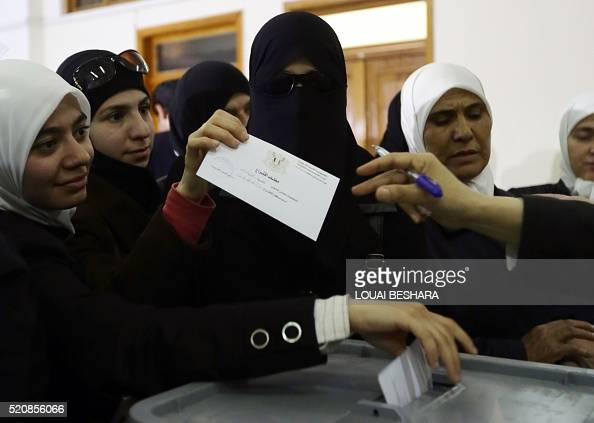 TOPSHOT Syrian women vote in the parliamentary elections at a polling station in Damascus on April 13 2016 Polls opened in areas of war torn Syria...
