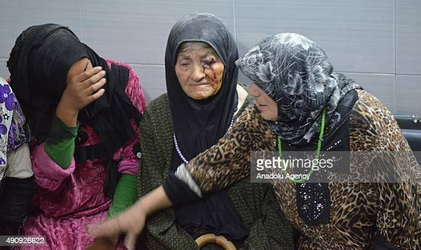 Syrian women wait for treatment at a field hospital after being injured in the Russian strikes targeting a camp near Belyun town in Jabal al Zawiya...