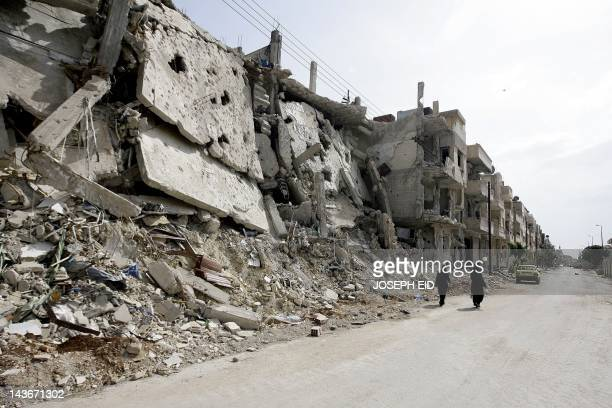 Syrian women walk past destruction in the Baba Amr neighbourhood of Homs on May 2 2012 The head of the UN mission to Syria said on May 2 his...