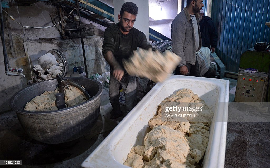 A Syrian worker moves the dough at a rebel-run bakery in Jabal al-Akrad region, northeast of Latakia province, late January 22, 2013. Several flashpoints in Syria's conflict, chiefly Damascus and Aleppo in the north, have been struck by a severe bread shortage and a lack of fuel used for cooking, heating and transportation.