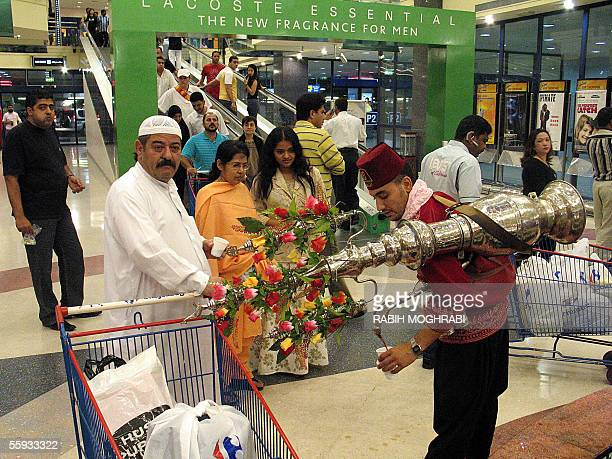 Syrian worker wearing traditional clothes offers the Ramadan 'Tamr Hindi' juice to Dubai residents after the breaking of the fast in Dubai 16 October...