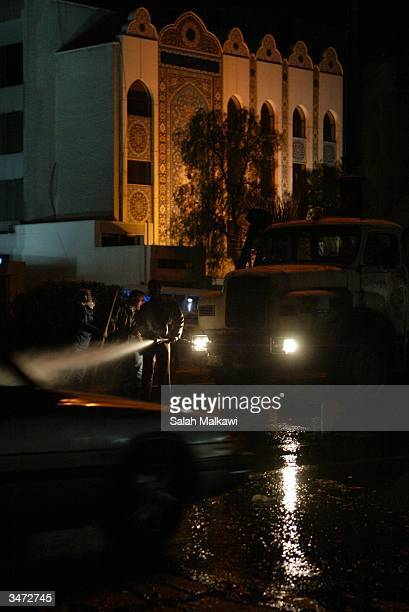 Syrian workers clean the street in front of the Iranian Embassy April 28 2004 in Damascus Syria Four terrorists attacked a former UN buiding near a...