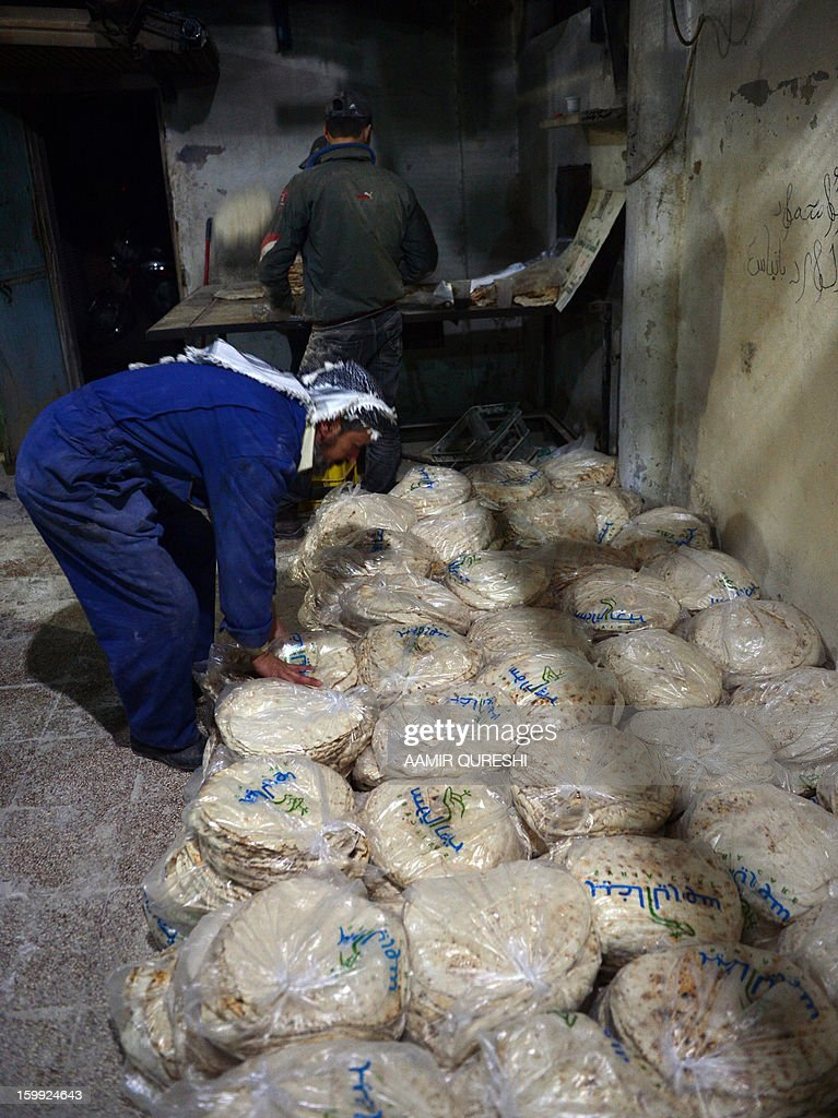 Syrian workers pack bread at a rebel-run bakery in Jabal al-Akrad region, northeast of Latakia province, late January 22, 2013. Several flashpoints in Syria's conflict, chiefly Damascus and Aleppo in the north, have been struck by a severe bread shortage and a lack of fuel used for cooking, heating and transportation.