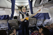 SyrianAir flight attendants present security measures to passengers during a flight between the capital Damascus and the Mediterranean port city of...