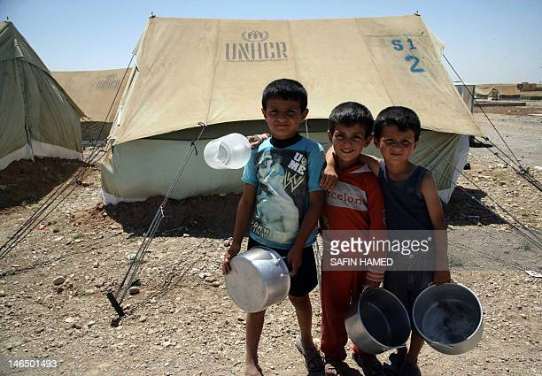 SyrianKurdish children pose for a photo on June 8 2012 at Domiz refugee camp 20 km southeast of Dohuk city which hosts refugees of all stripes from...
