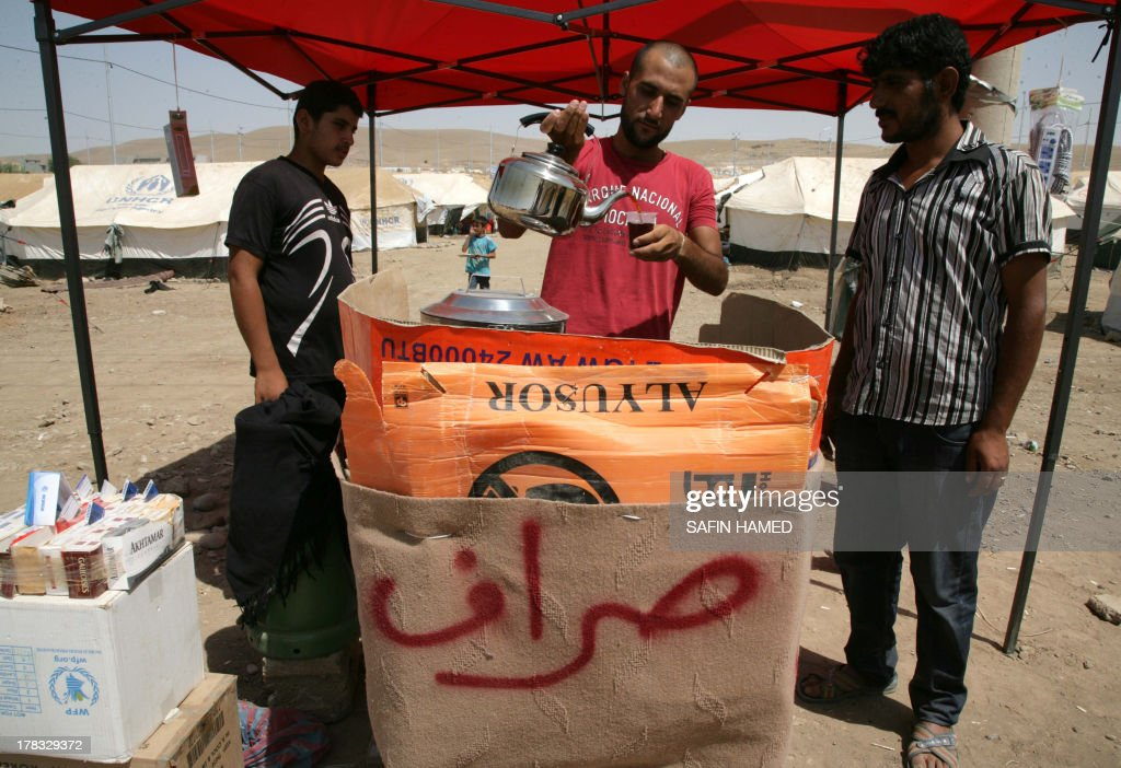A Syrian-Kurdish man pours a cup of tea at the Quru Gusik refugee camp, 20 kilometres east of Arbil, the capital of the autonomous Kurdish region of northern Iraq, on August 29, 2013. Over 1.9 million Syrians in total have fled their homeland, mostly to neighbouring Arab states and Turkey, since the revolt against President Bashar al-Assad erupted in 2011.