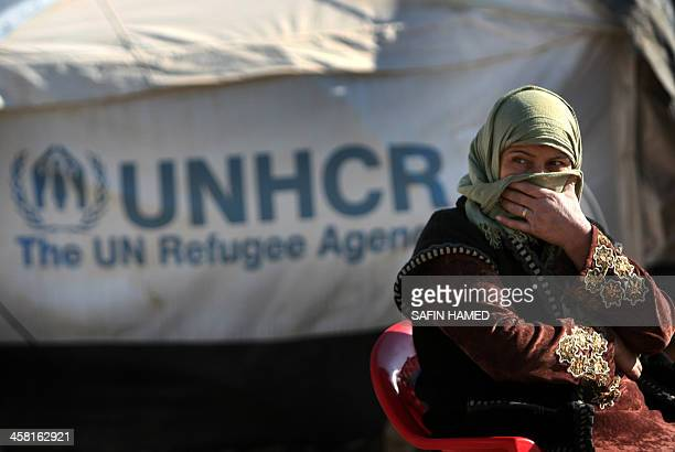A SyrianKurdish refugee woman sits at the Quru Gusik refugee camp 20 kilometers east of Arbil the capital of the autonomous Kurdish region of...