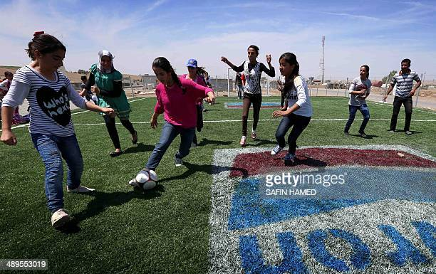 SyrianKurdish refugees play football at the Quru Gusik refugee camp 20 kilometres east of Arbil the capital of the autonomous Kurdish region of...