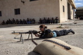 A SyrianKurdish young woman practices for shooting during a training session organized by the Kurdish Defense Units on October 19 2013 in the Kurdish...