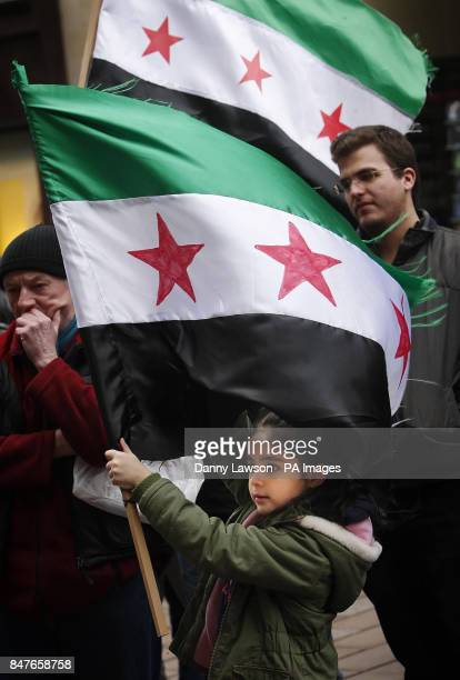 Syrians and Friends of Syria protest on Buchanan Street in Glasgow Scotland to raise awareness about the crisis in Homs to reject Assad's referendum...