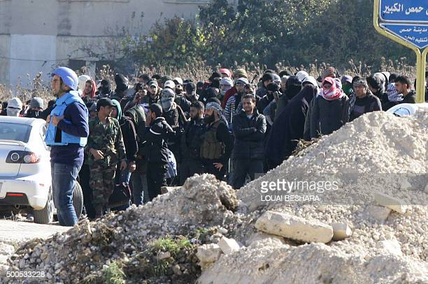 Syrians and members of the Syrian government forces gather as hundreds of civilians and Syrian rebel forces began evacuating the last oppositionheld...