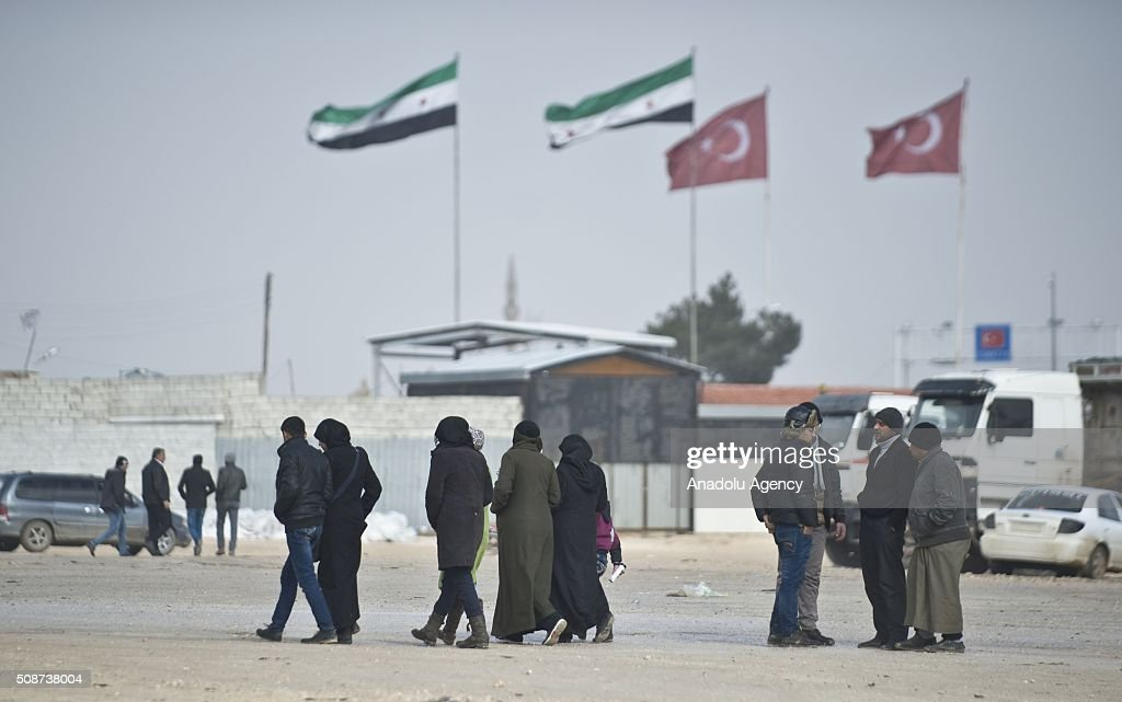 Syrians are seen at Bab al-Salam border on Turkey's border in Azez district of Aleppo as they flee to Turkey to escape heavy Syrian regime and Russian airstrikes, on February 6, 2016.