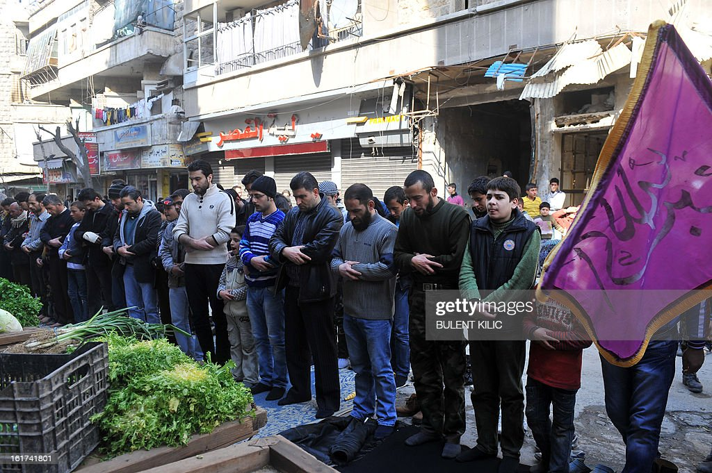 Syrians attend Friday prayer in the northeastern city of Aleppo on February 15, 2013. Turkish artillery struck back after a shell fired from neighbouring Syria ploughed into Turkish territory without causing any casualties, the state-run news agency reported. AFP PHOTO/BULENT KILIC