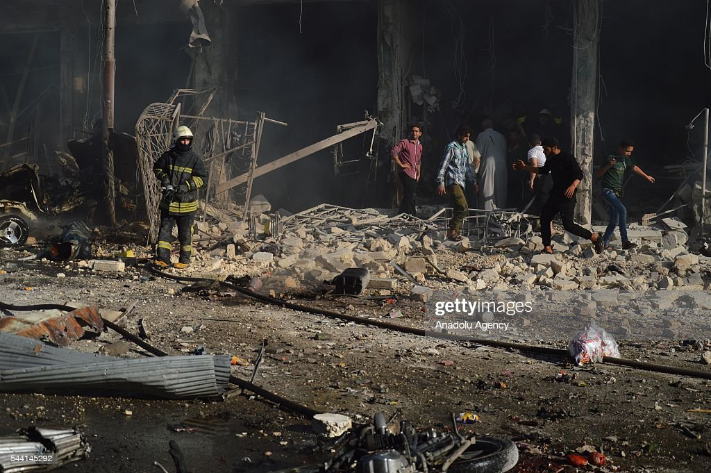 Syrians attend rescue operation after belonging to the Syrian army carried out airstrikes on residential areas in the opposition controlled Tariq al-Bab neighborhood in Aleppo, Syria on July 1, 2016.