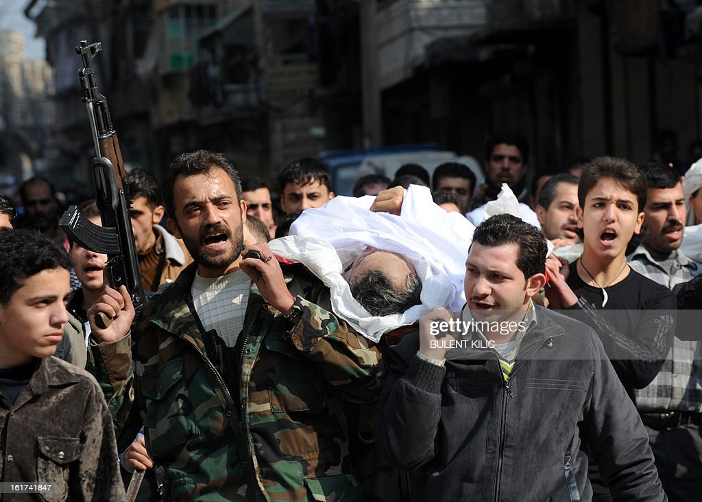 Syrians carry a body of a fighter during a funeral after Friday prayer in the northeastern city of Aleppo on February 15, 2013. Syria's army and rebels were preparing for a major battle for control of strategic airports in Aleppo, the Syrian Observatory for Human Rights said, four days after insurgents launched assaults on airbases in the northern province.