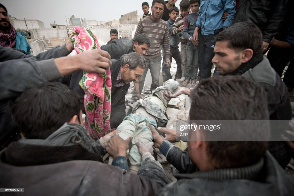 Syrians carry the body of a 6-year-old girl found under the rubble of a building in the Tariq al-Bab district of the northern city of Aleppo on February 23, 2013. Three surface-to-surface missiles fired by Syrian regime forces in Aleppo's Tariq al-Bab district have left 58 people dead, among them 36 children, the Syrian Observatory for Human Rights said on February 24. AFP PHOTO/PABLO TOSCO