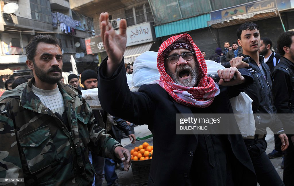 Syrians carry the body of a fighter during a funeral after Friday prayer in the northeastern city of Aleppo on February 15, 2013. Syria's army and rebels were preparing for a major battle for control of strategic airports in Aleppo, the Syrian Observatory for Human Rights said, four days after insurgents launched assaults on airbases in the northern province.