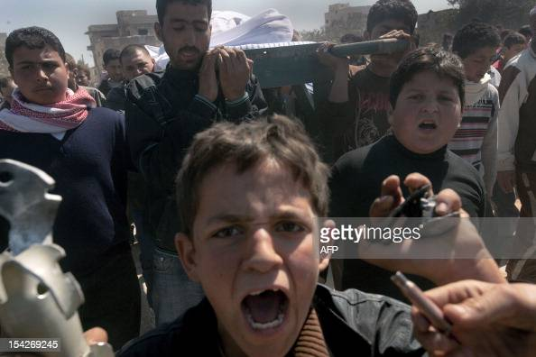 Syrians carry the coffin of 13yearold Ahmad bin Muhsin Qarush during his funeral on March 24 2012 who was reportedly killed two days earlier in...