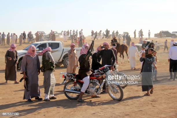 Syrians celebrate the victory of a friend during a horse race for thoroughbred Arabian horses sponsored by Turkish NGO IHH on May 12 in the southern...