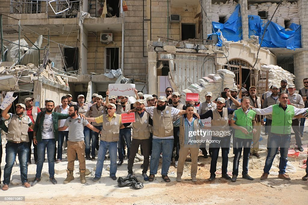 Syrians chant slogans and hold banners during a protest against Russian airstrikes on Jerusalem field hospital in the Sukkeri neighborhood of Aleppo, Syria on May 01, 2016.