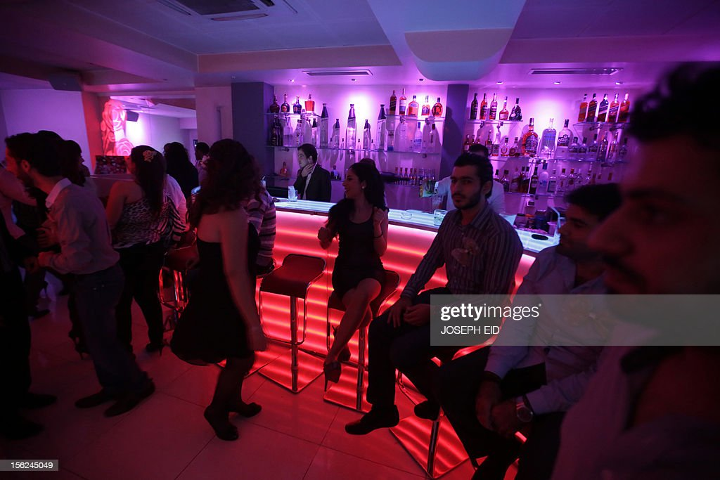 Syrians dance at a nightclub in Damascus on November 11, 2012. Despite the nearly 20-month long conflict between government troops and the rebels many Syrians are still going out to local bars. AFP PHOTO/JOSEPH EID