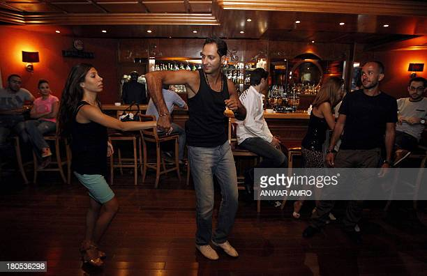 Syrians dance in a night club in the capital Damascus on September 14 2013 Iran's deputy foreign minister said the United States no longer has a...
