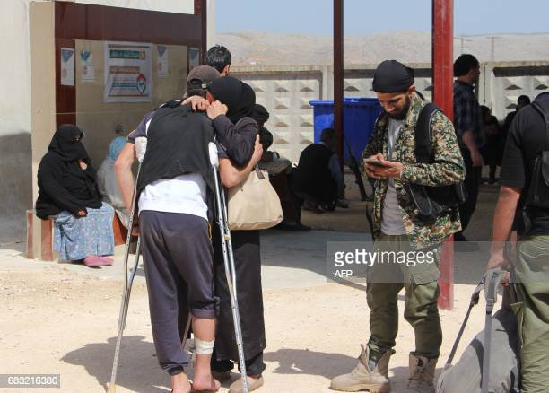 Syrians embrace as civilians and rebels who were evacuated from the Qabun district in northeast Damascus arrive at a temporary camp in the northern...