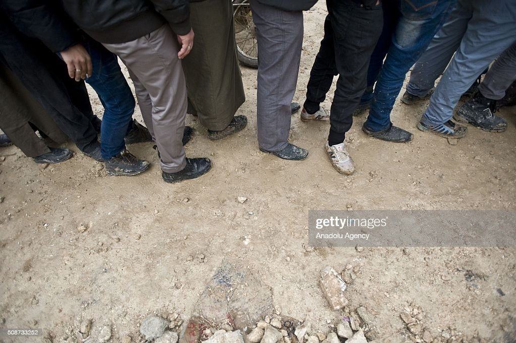 Syrians, fled from their homes due to Russian and Assad Regime forces attacks, come into line to register to stay in tents on the way between Aleppo and Azez to in Syria on February 6, 2016.