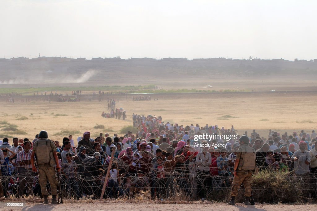 Syrians fleeing from clashes between the Islamic State of Iraq and Levant militants and Democratic Union Party forces in the ArRaqqah Governorate of...