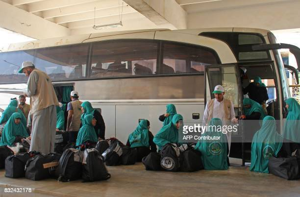 Syrians from the northwestern province of Idlib wait to board buses at the Bab alHawa border crossing on August 16 2017 as they head to Turkey prior...