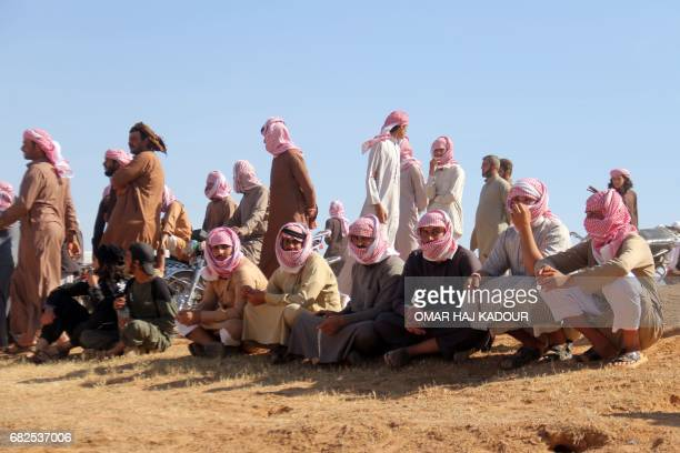 Syrians gather to watch a horse race for thoroughbred Arabian horses sponsored by Turkish NGO IHH on May 12 in the southern Aleppo countryside In...
