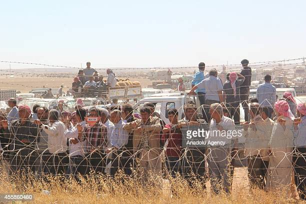 Syrians gathering on TurkishSyrian border after fleeing from the clashes between the Islamic State of Iraq and Levant militants and Democratic Union...