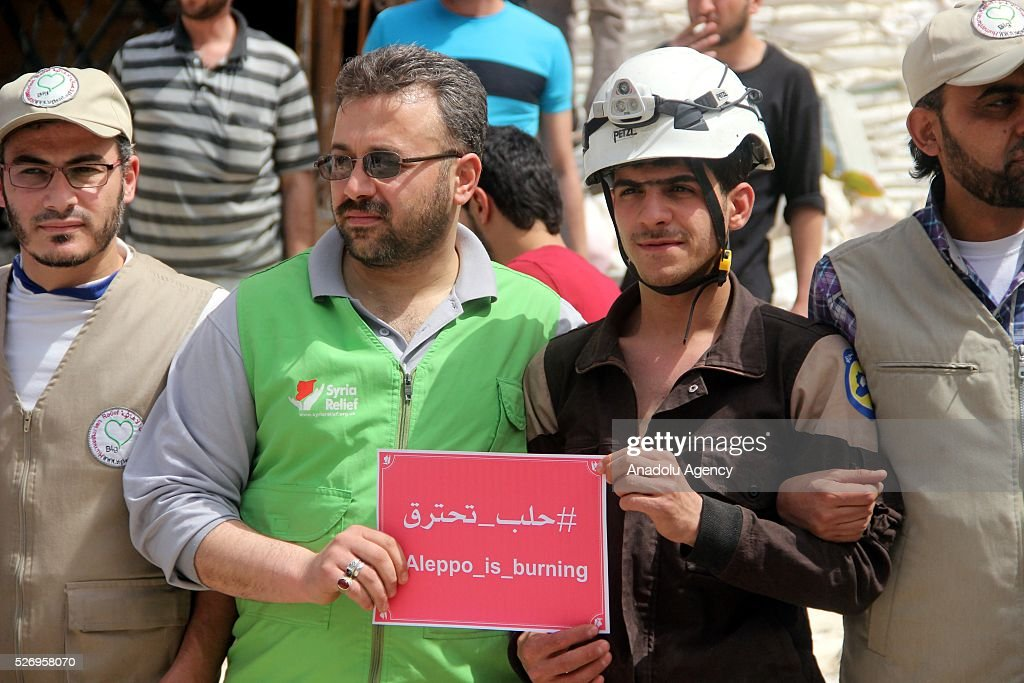 Syrians hold banners during a protest against Russian airstrikes on Jerusalem field hospital in the Sukkeri neighborhood of Aleppo, Syria on May 01, 2016.