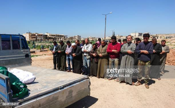 Syrians hold funeral prayers before they bury the bodies of victims of a a suspected toxic gas attack in Khan Sheikhun a nearby rebelheld town in...