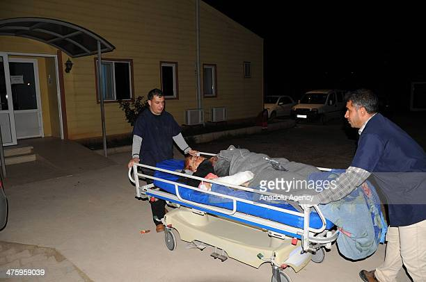 Syrians injured by barrel bombattacks dropped by regime helicopters in Aleppo has been brought to Turkey's Hatay town for treatment on March 1 2014 2...
