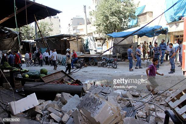 Syrians inspect a damaged bazaar after a helicopter belonging to the Syrian Army bombed a residential areas in the Firdevs region of Aleppo Syria on...