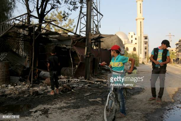 Syrians inspect the damage of houses after Assad Regime's forces carried out their strikes over the deconflict zone Kafr Batna district in the...