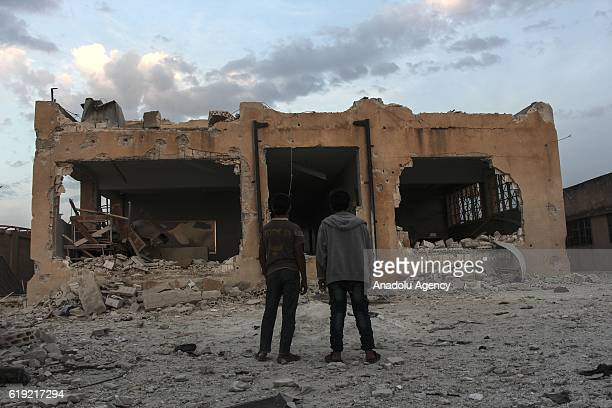 Syrians inspect the Haas School which was destroyed by the vacuum bomb attacks carried out by the Syrian regime and allied war planes four days ago...