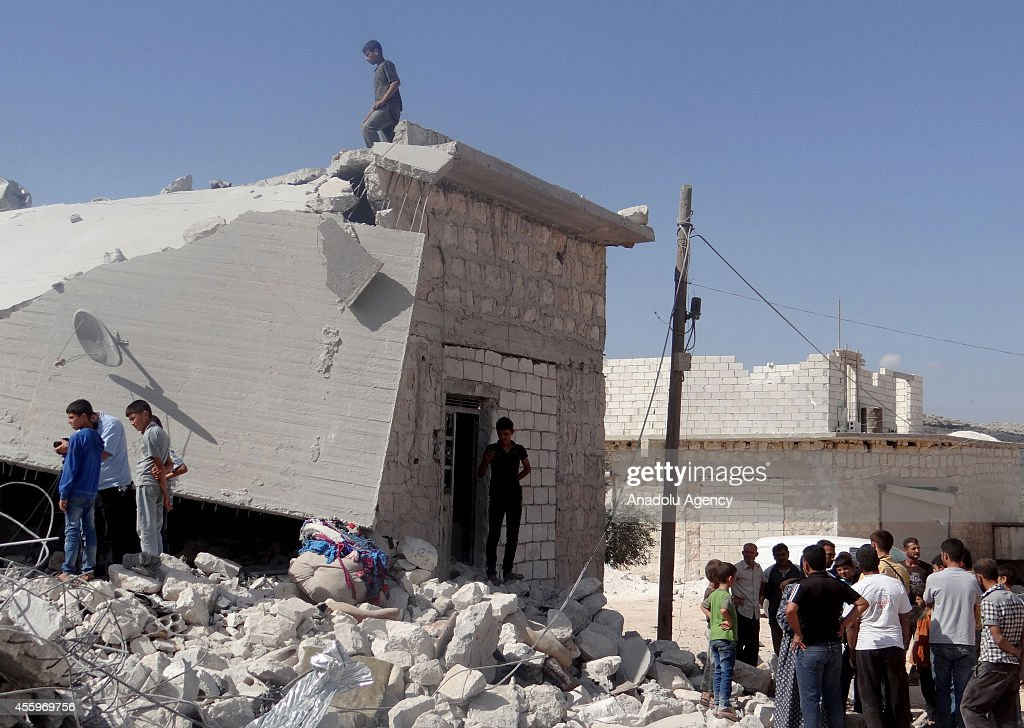 Syrians inspect the rubble of destroyed houses following the USled coalition's airstrikes against the Islamic State of Iraq and the Levant on a...