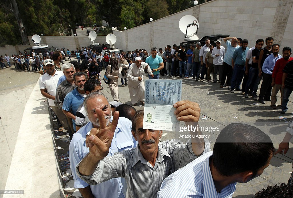 Syrians living in Lebanon wait in a queue during the second day of Syrian presidential elections at the Syrian Embassy in capital Beirut, Lebanon on May 29, 2014. The election will be held inside Syria on June 3, 2014.