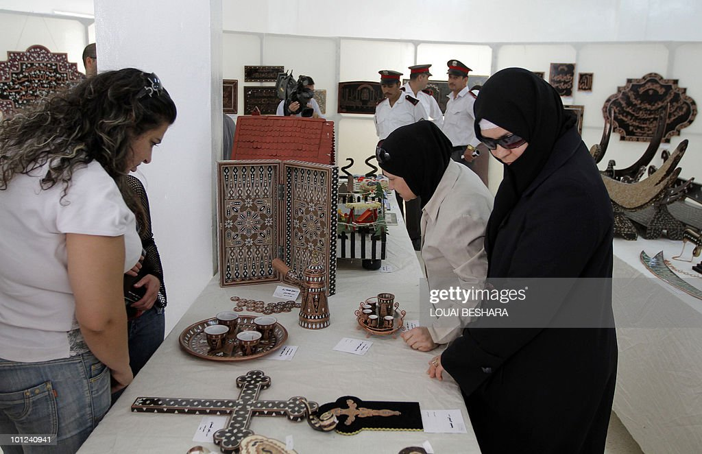 ISSA Syrians look at items made by prisoners on display at the Damascus central Jail in the Syrian capital on May 28, 2010.