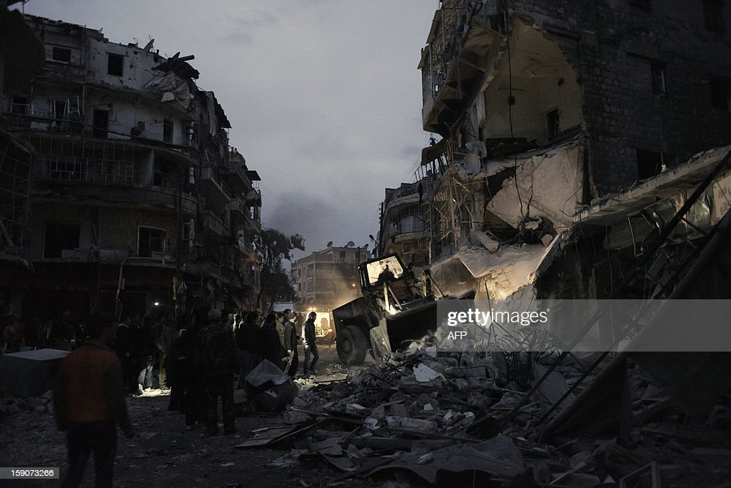 Syrians look for survivors at the rubble of a building targeted by a missile in the al-Mashhad neighbourhood of Aleppo on January 7, 2013. The United Nations recently denounced a 'proliferation of serious crimes including war crimes' in Syria, as ever more horrifying images and videos emerge from the country. AFP PHOTO / ACHILLEAS ZAVALLIS