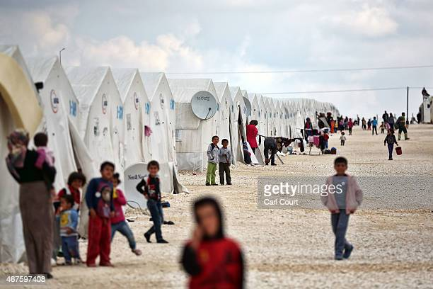 Syrians pass the time in Suruc refugee camp on March 25 2015 in Suruc Turkey The camp is the largest of its kind in Turkey with a population of...