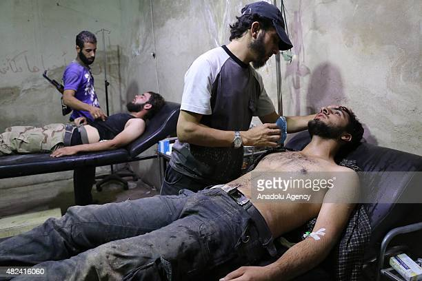 Syrians receive treatment at a field hospital following a chlorine gas attack by Assad regime forces in Jobar town of Damascus Syria on July 30 2015