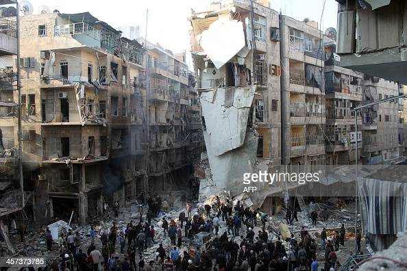 Syrians search for survivors amidst the rubble following an airstrike in the Shaar neighborhood of Aleppo on December 17 2013 Two children were among...