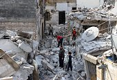 Syrians search through the rubble of buildings for reusable items in the Kalasa neighbourhood of the northern Syrian city of Aleppo on October 28...
