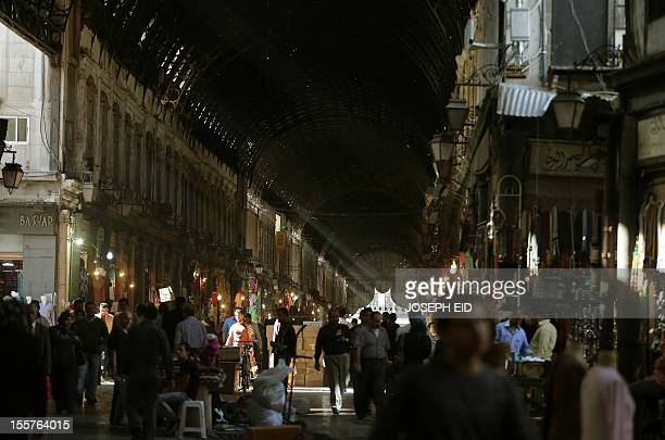 Syrians shop at the AlHamidiyah market in the old city of Damascus on November 8 2012 Long spared the violence that has engulfed the rest of the...