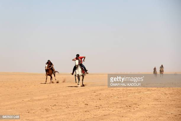 Syrians take part in a horse race for thoroughbred Arabian horses sponsored by Turkish NGO IHH on May 12 in the southern Aleppo countryside In 2010...